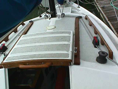 Cabintop Showing Winches Sheet Stoppers And Mounts For The Dodger Access Plate In Front Of Sliding Hatch Is Keel Winch